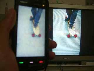 Liat foto di tv