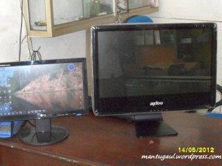 Perbandingan dengan LCD 14 inci